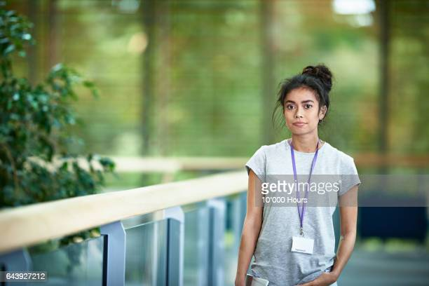 portrait of woman in modern office. - id card stock pictures, royalty-free photos & images