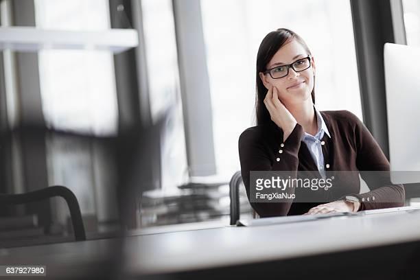 Portrait of woman in modern office setting