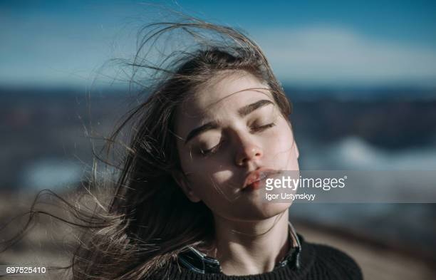 portrait of woman in mountains - eyes closed stock pictures, royalty-free photos & images