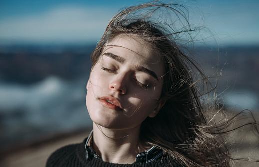Portrait of woman in mountains - gettyimageskorea