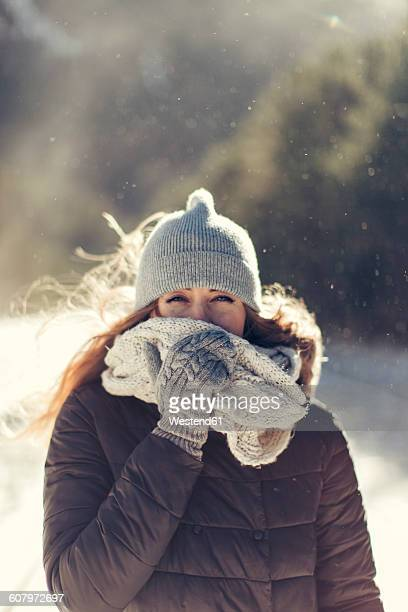 portrait of woman in nature wearing warm clothing - 防寒着 ストックフォトと画像