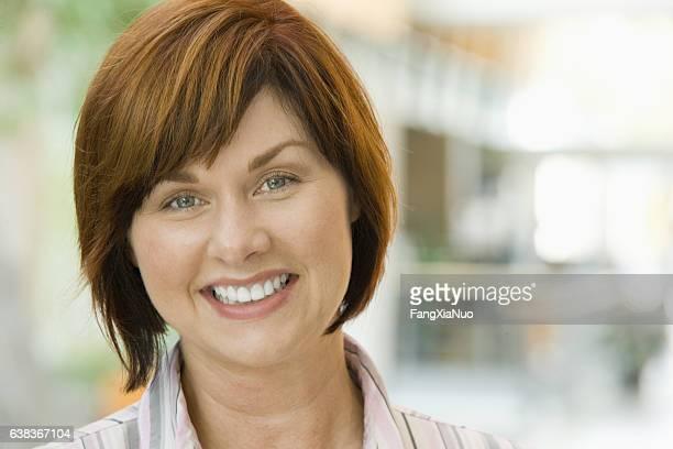 Portrait of woman in office lobby