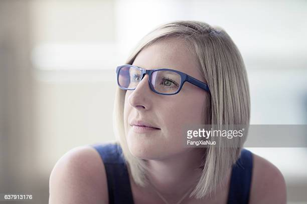 portrait of woman in office - soft focus stock pictures, royalty-free photos & images