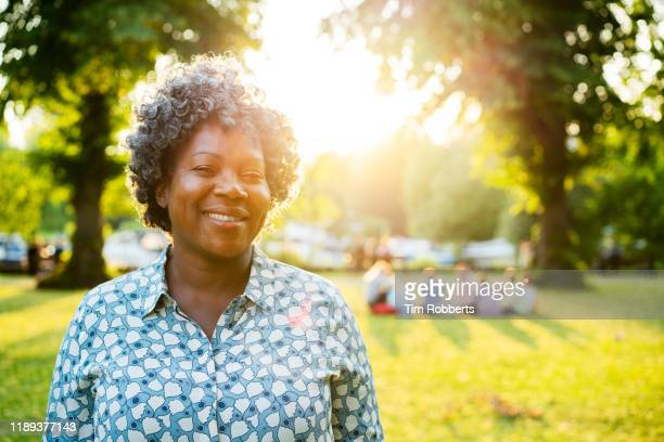portrait of woman in park - twilight stock pictures, royalty-free photos & images