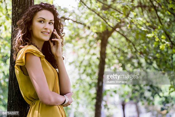 Portrait of woman in park talking on mobile phone