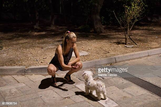 Portrait of woman in park with Maltese dog