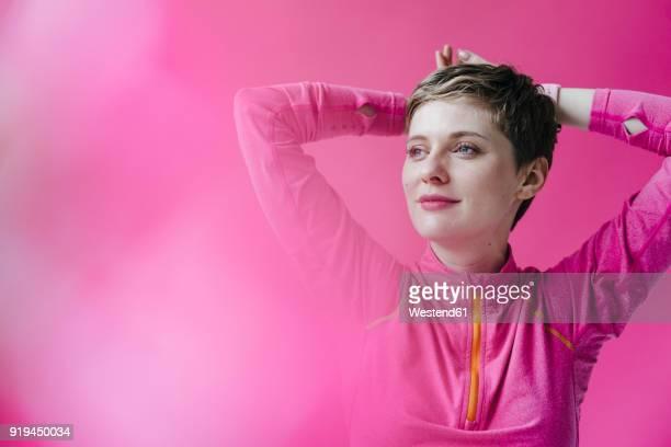 Portrait of woman in pink sportswear