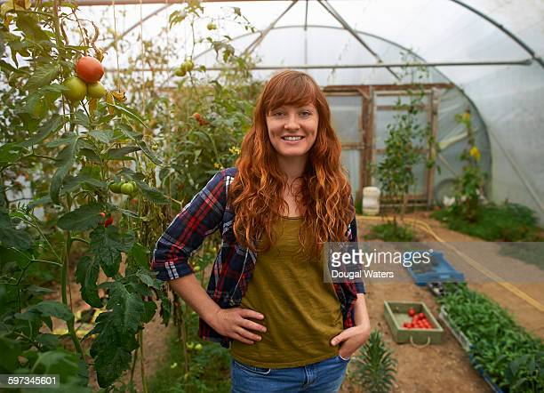 Portrait of woman in poly tunnel.