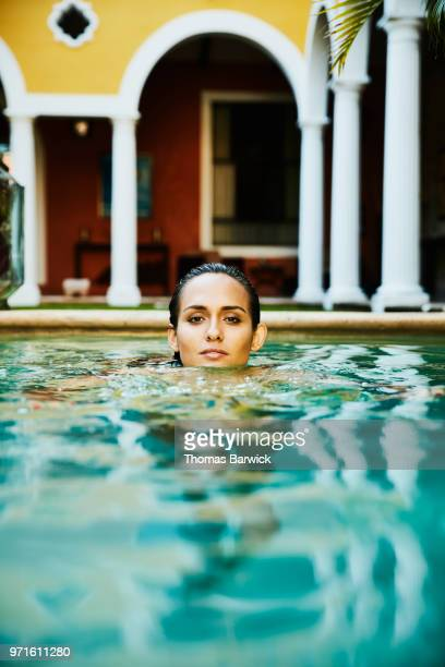 Portrait of woman in pool at luxury hotel