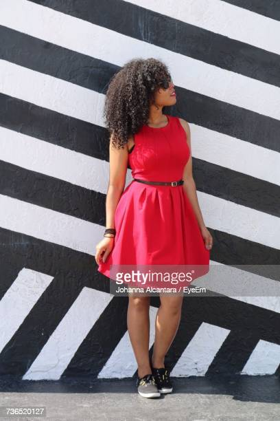 portrait of woman in red dress - striped dress stock photos and pictures