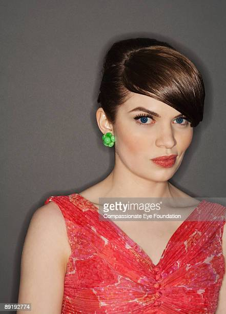 """portrait of woman in red dress with green earrings - """"compassionate eye"""" stock pictures, royalty-free photos & images"""