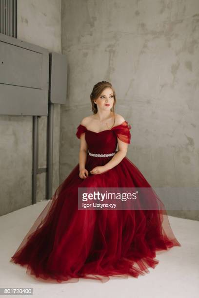 portrait of woman in  red prom dress  in studio - prom dress stock pictures, royalty-free photos & images