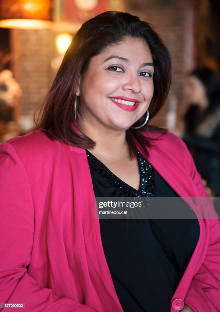 Portrait of woman in smart casual clothes in a bar. : Stock Photo