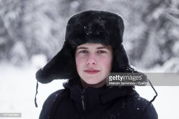 portrait of woman in snow outdoors during winter - fur hat stock pictures, royalty-free photos & images