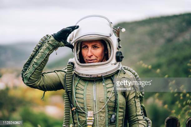 portrait of woman in space suit exploring nature - traje espacial fotografías e imágenes de stock