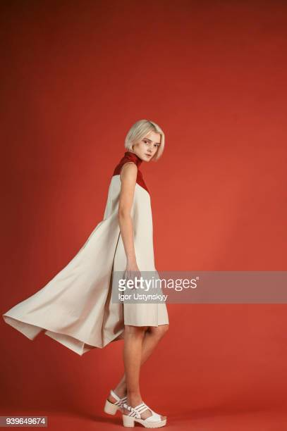 portrait of woman in studio on the red background - model stock-fotos und bilder