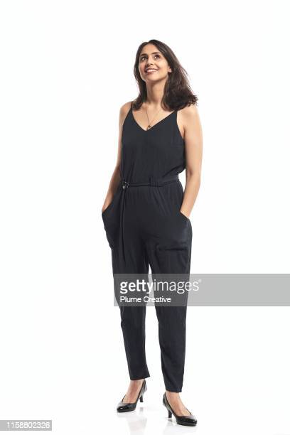 portrait of woman in studio - full length stock pictures, royalty-free photos & images