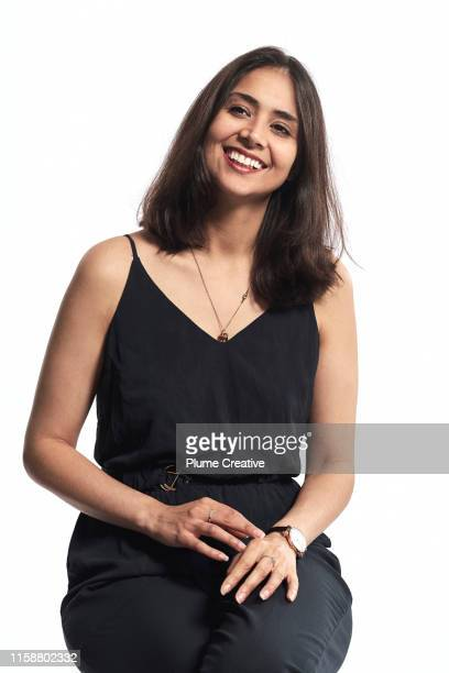 portrait of woman in studio - sitting stock pictures, royalty-free photos & images