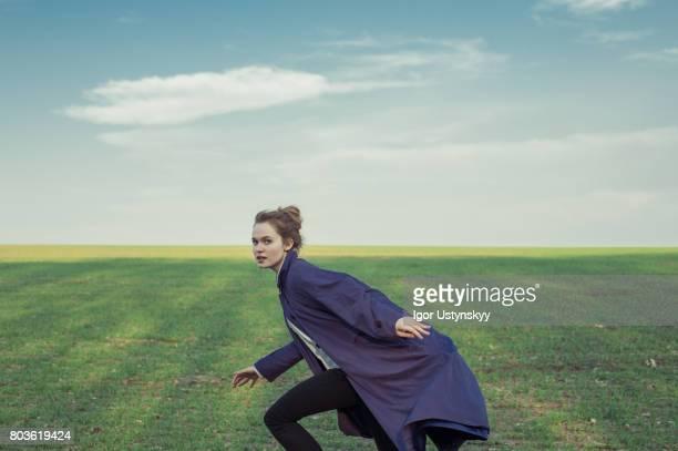 Portrait of woman in the field in coat