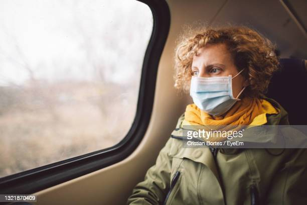 portrait of woman in train - bortes stock pictures, royalty-free photos & images