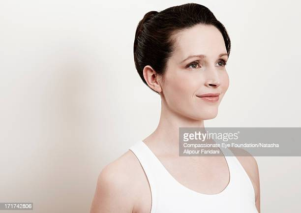 "portrait of woman in white vest, side view - ""compassionate eye"" stock pictures, royalty-free photos & images"