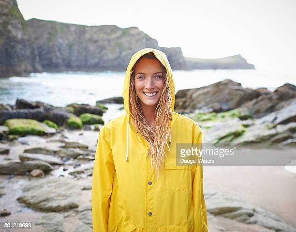 Portrait of woman in yellow raincoat