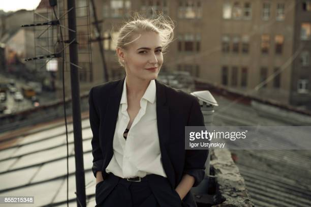 portrait  of woman indoors - pant suit stock pictures, royalty-free photos & images
