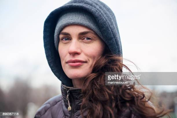 """portrait of woman jogging in city public park in winter. - """"martine doucet"""" or martinedoucet stock pictures, royalty-free photos & images"""