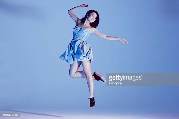portrait of woman jumping - dress stock pictures, royalty-free photos & images