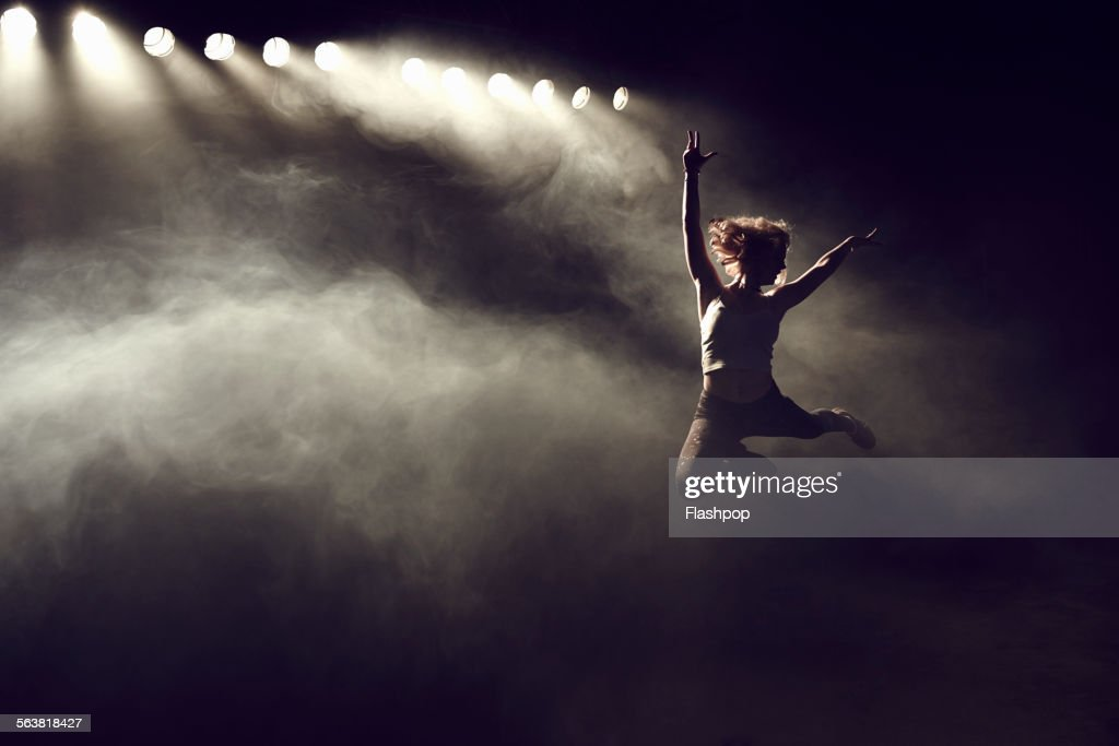 Portrait of woman jumping : Photo