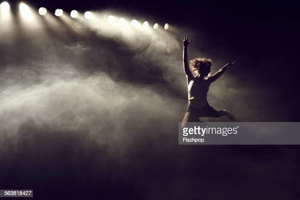 portrait of woman jumping - gymnastics stock pictures, royalty-free photos & images