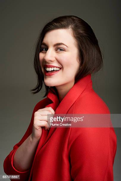 Portrait of woman laughing in a red jacket
