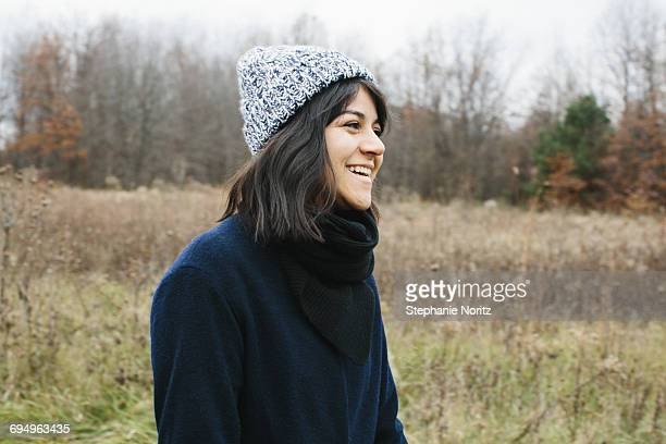 Portrait of woman laughing in the park