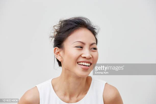 portrait of woman laughing - looking away stock pictures, royalty-free photos & images