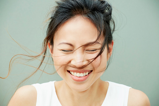 Portrait of woman laughing - gettyimageskorea