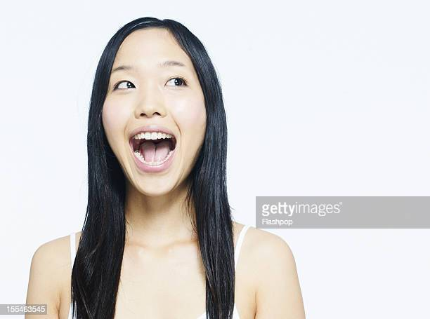 portrait of woman laughing - mouth open stock pictures, royalty-free photos & images