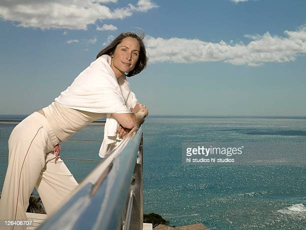 Portrait of woman leaning on railing