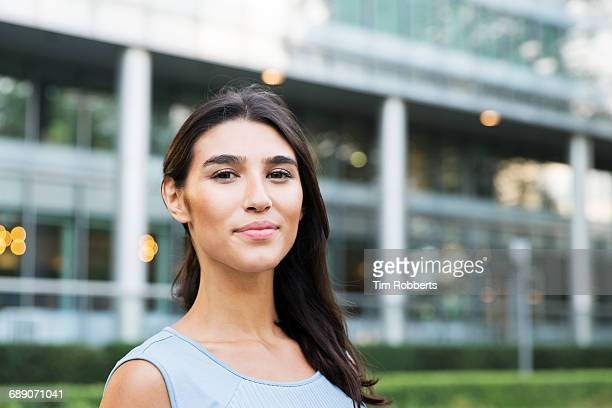 portrait of woman looking at camera - sleeveless stock pictures, royalty-free photos & images