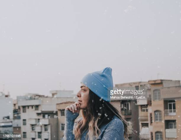 portrait of woman looking at city against sky - tehran stock pictures, royalty-free photos & images