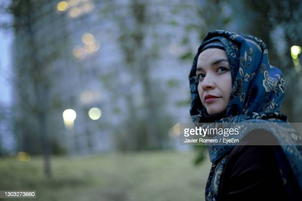 portrait of woman looking away in winter - qatar stock pictures, royalty-free photos & images