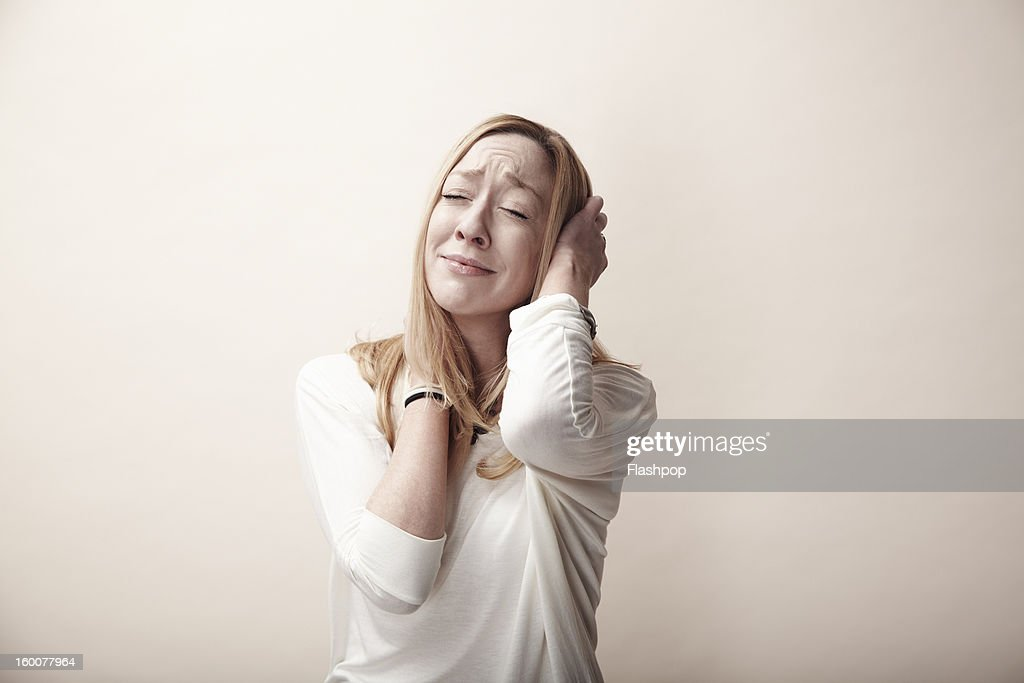 Portrait of woman looking distressed : Stock Photo