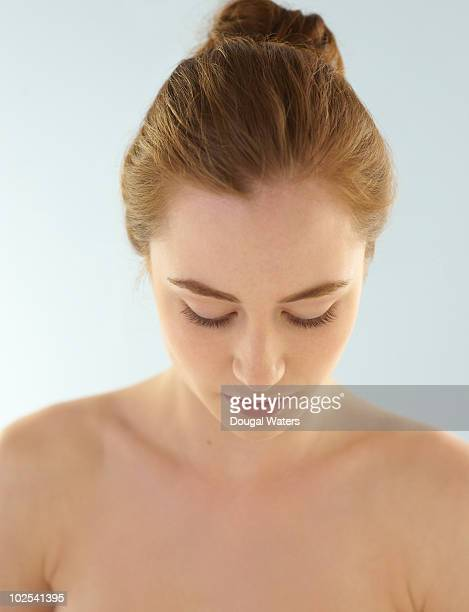 Portrait of woman looking down.