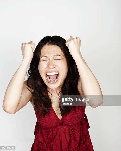 portrait of woman looking frustrated - shouting stock photos and pictures