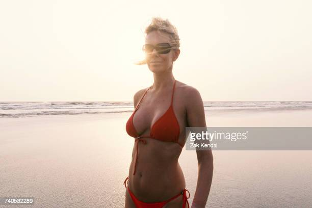 Portrait of woman on beach wearing bikini, Goa, India, Asia
