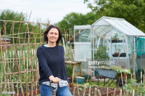 portrait of woman on her allotment - richard drury stock pictures, royalty-free photos & images