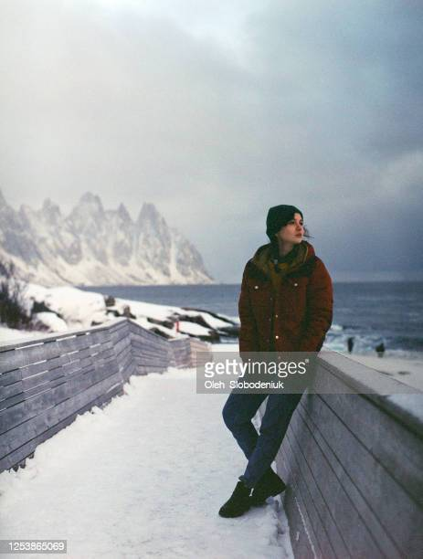 portrait of woman on lofoten island in snow - scandinavian ethnicity stock pictures, royalty-free photos & images