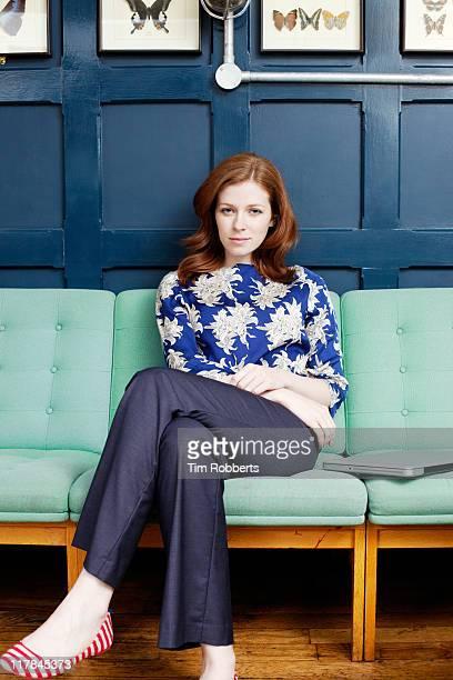 Portrait of woman on sofa.
