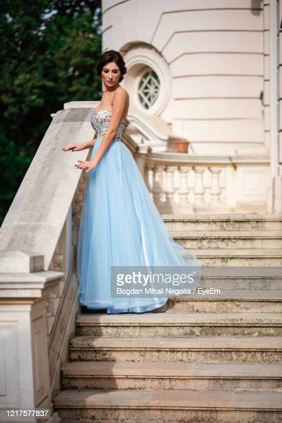 portrait of woman on staircase - evening gown stock pictures, royalty-free photos & images