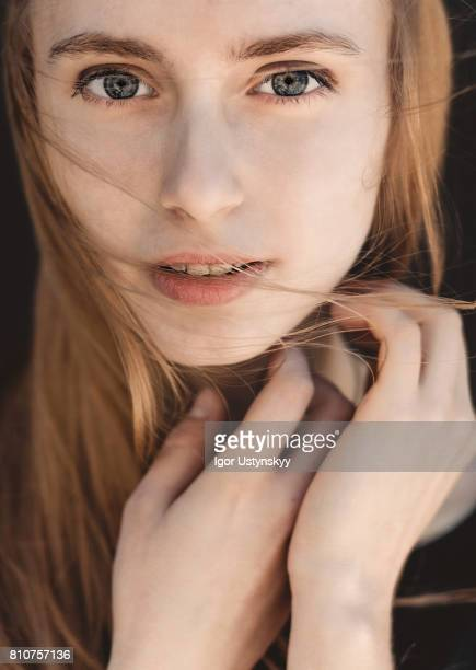 portrait of woman on the black background - no make up stock pictures, royalty-free photos & images