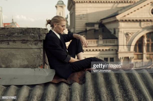 portrait  of woman  on the roof - tomboy stock photos and pictures